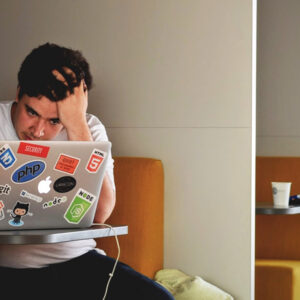 Effects of Stress - a young man on a computer